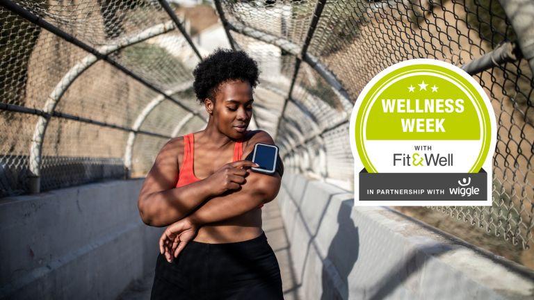 Wellness Week Woman on run adjusting music