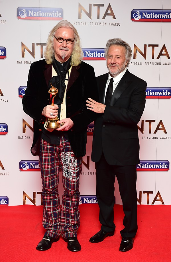 Dustin Hoffman presents Billy Connolly with the Special Recognition Award in the press room at the National Television Awards 2016 (Ian West)