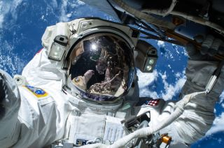 "NASA astronaut Barry ""Butch"" Wilmore is shown during a spacewalk on Feb. 21, 2015. Fellow spacewalker Terry Virts, who took the picture, is reflected in Wilmore's visor."