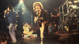 AC/DC perform their top songs on stage