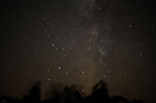 Stargazers on the Isle of Sark, in the Channel Islands off the coast of England, enjoy the wonder of the Milky Way.