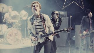 A photograph of The Damned on stage in 1977