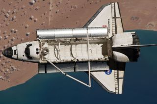 Space shuttle Discovery sails high over the southwestern coast of Morocco in this image taken by International Space Station astronauts just after the two vehicles undocked on March 7, 2011 during the STS-133 mission.