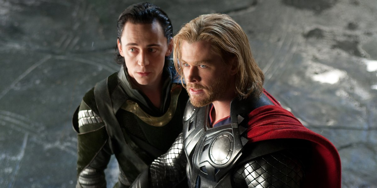 Tom Hiddleston and Chris Hemsworth stand together, in costume, in Thor.