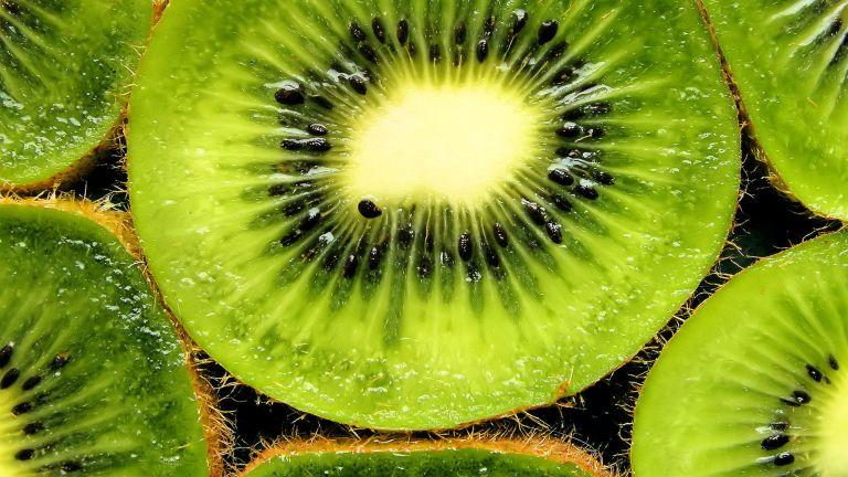 Kiwis cut open showing the colourful inside flesh