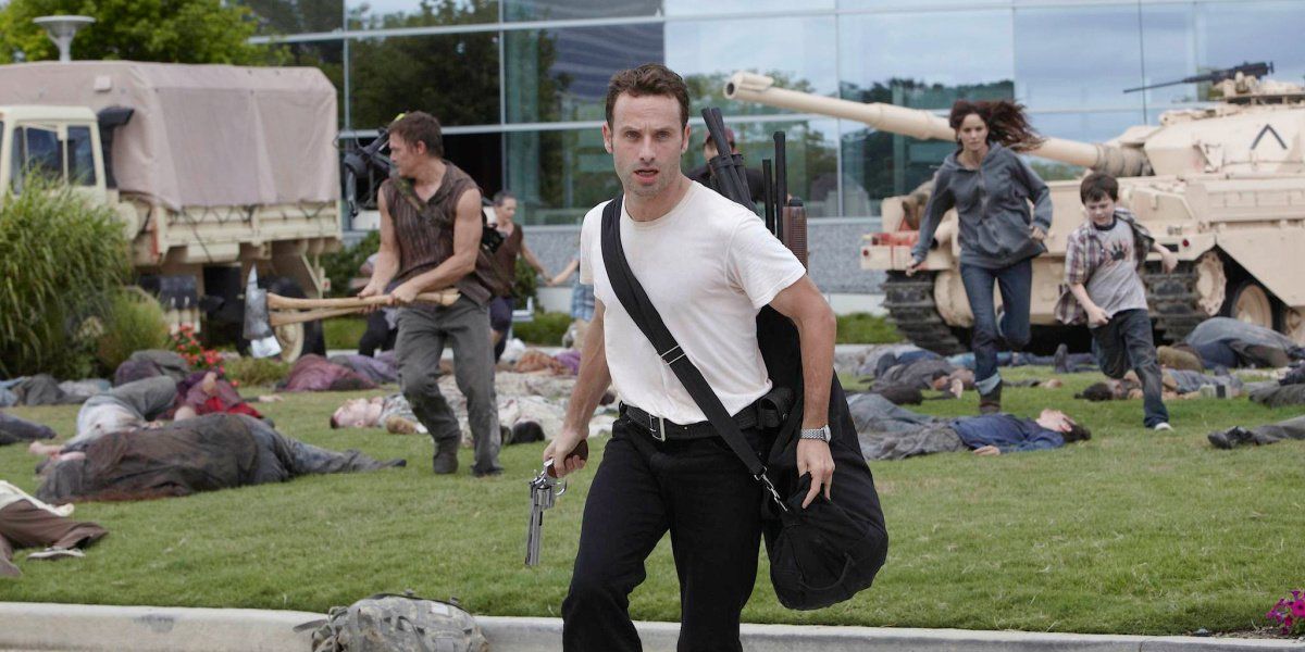 Rick and the group running from the CDC in The Walking Dead.
