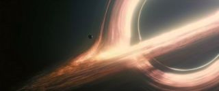 "A supermassive black hole, as visualized in the 2014 sci-fi blockbuster ""Interstellar."""