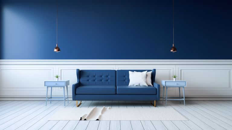 white area rug with blue couch