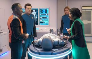 The Orville crew bring Isaac to his home planet.