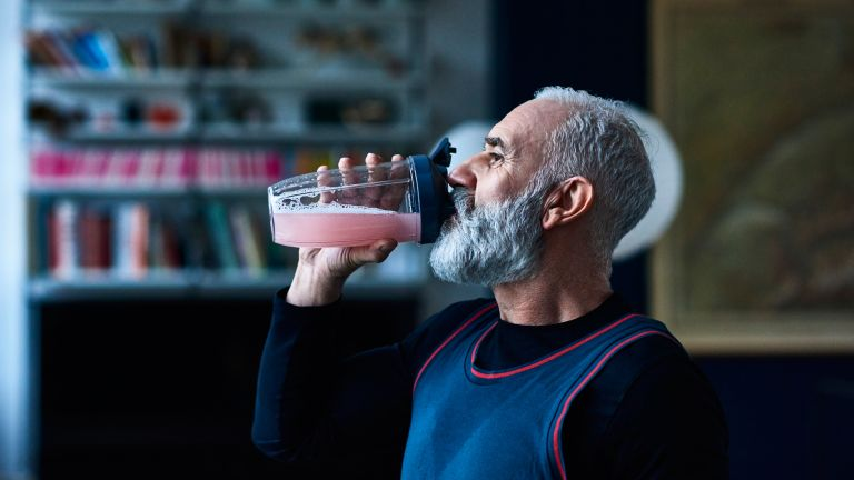 Man drinking a shake made with the best protein Powder for weight loss