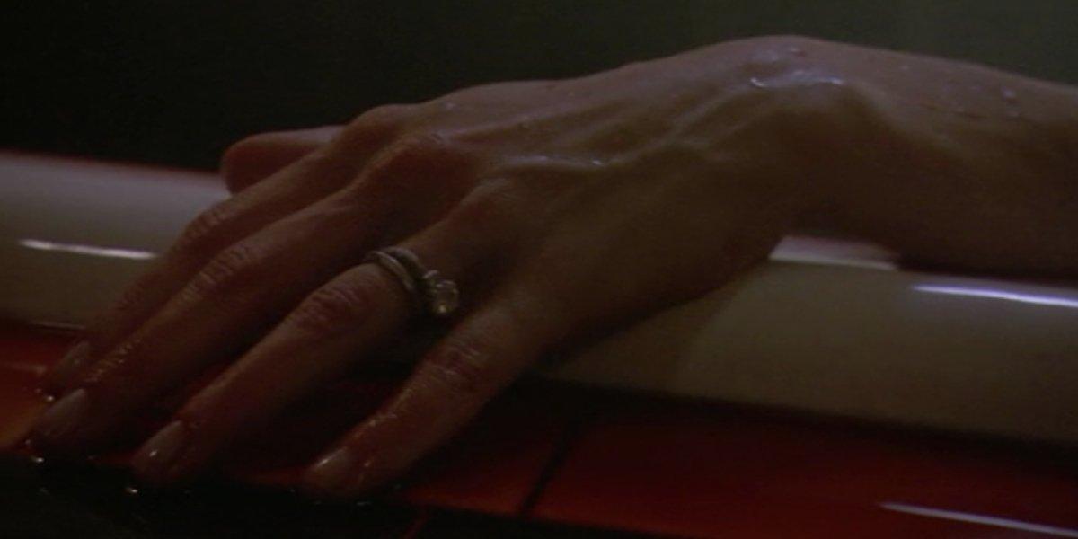 Julie Benz's hand on Dexter