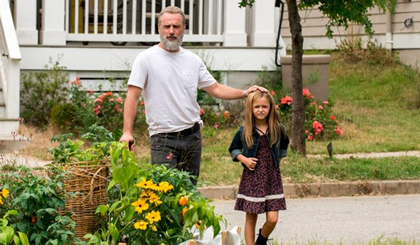 Andrew Lincoln as Rick Grimes and Kinsley Isla Dillon as Judith Grimes on AMC's The Walking Dead