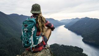 buy a hat: woman wearing cap above lake