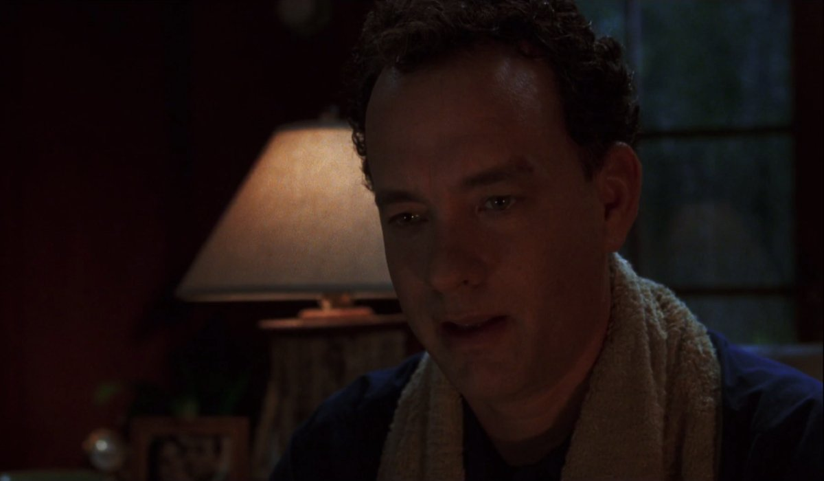 Cast Away Tom Hanks sits teary eyed in a study