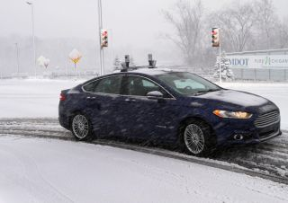 One of Ford's autonomous vehicles during winter-weather testing in a simulated environment.