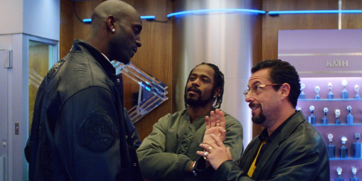 Uncut Gems Kevin Garnett talks to Adam Sandler, while Lakeith Stanfield watches, in the jewelry stor