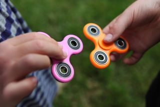 Two fidget spinners.