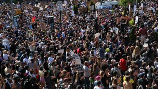 Crowds of people protest police brutality and the death of George Floyd in Brooklyn, New York, on May 30, 2020.