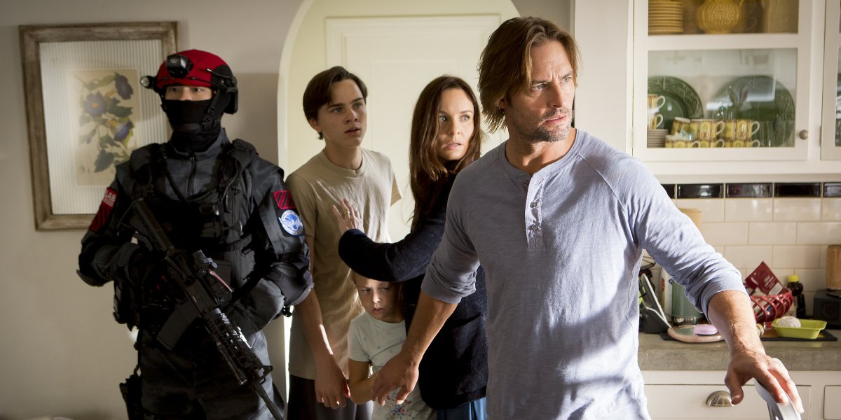 Josh Holloway and Sarah Wayne Callies are a family challenged by oppression in Colony