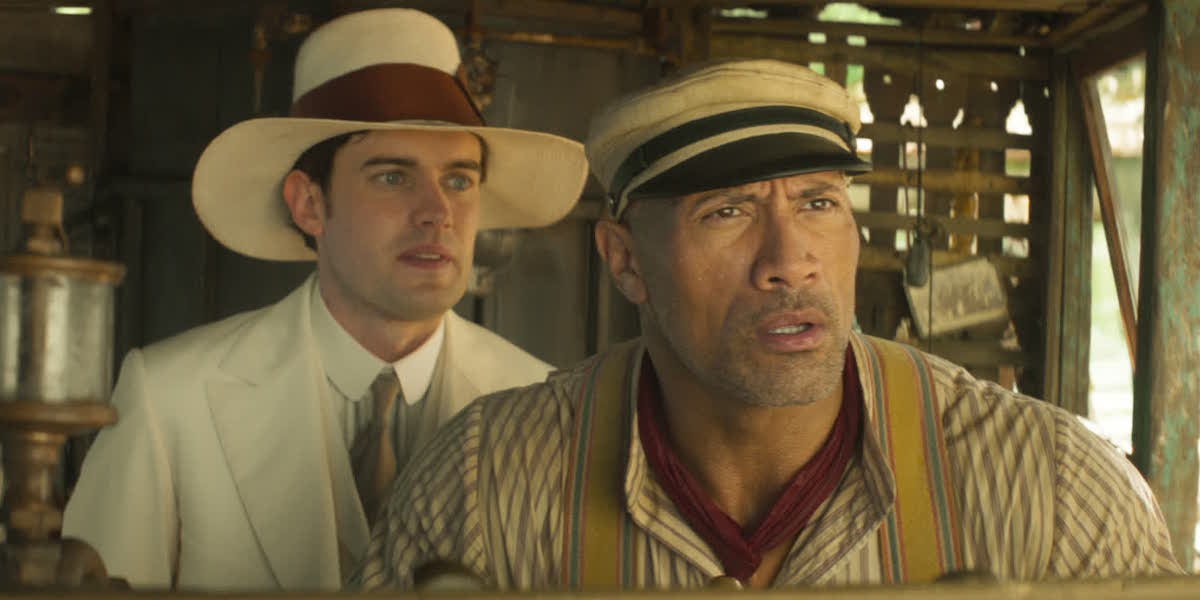 MacGregor Houghton (Jack Whitehall) stands behind Frank Wolff (Dwayne Johnson) in a scene from 'Jungle Cruise'