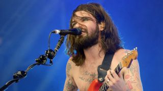 """You can break people's hearts with a guitar,"" says Biffy Clyro's Simon Neil, quickly adding, ""and smash their faces in a second later."""