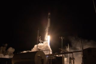 A Rocket Lab Electron booster carrying the StriX-α Earth-imaging satellite for the Japanese company Synspective lifts off from the company's Launch Complex 1 on the Mahia Peninsula in New Zealand on Dec. 15, 2020.
