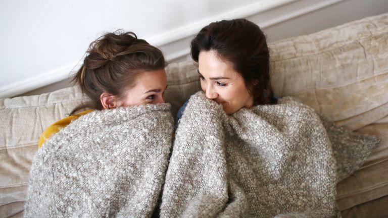 Women under a blanket