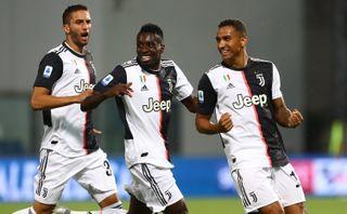 Juventus FC's Danilo (right) celebrates a goal with teammates Blaise Matuidi (center) and Rodrigo Betancur during a recent match. The squad takes on Lazio on July 20.