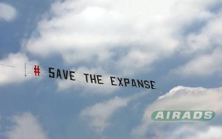 "A banner goes across the sky reading ""# SAVE THE EXPANSE"""