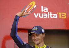 Nicolas Roche (Saxo-Tinkoff) celebrates on the podium after winning stage 2 of the 2013 Vuelta a Espana