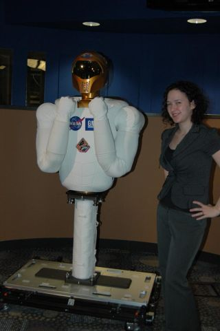Robonaut 2A poses for a photo with LiveScience Senior Writer Stephanie Pappas. NASA's Robonaut 2 is the first humanoid robot to be tested in space on the International Space Station.