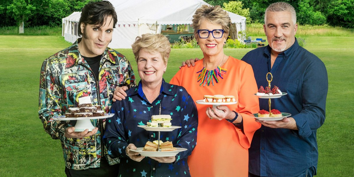 Great British Baking Show Noel, Sandi, Prue, and Paul holding desserts
