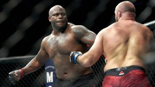 Derrick Lewis winds up a big punch in a UFC fight