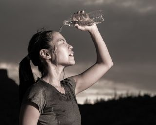 a female athlete cooling off with water