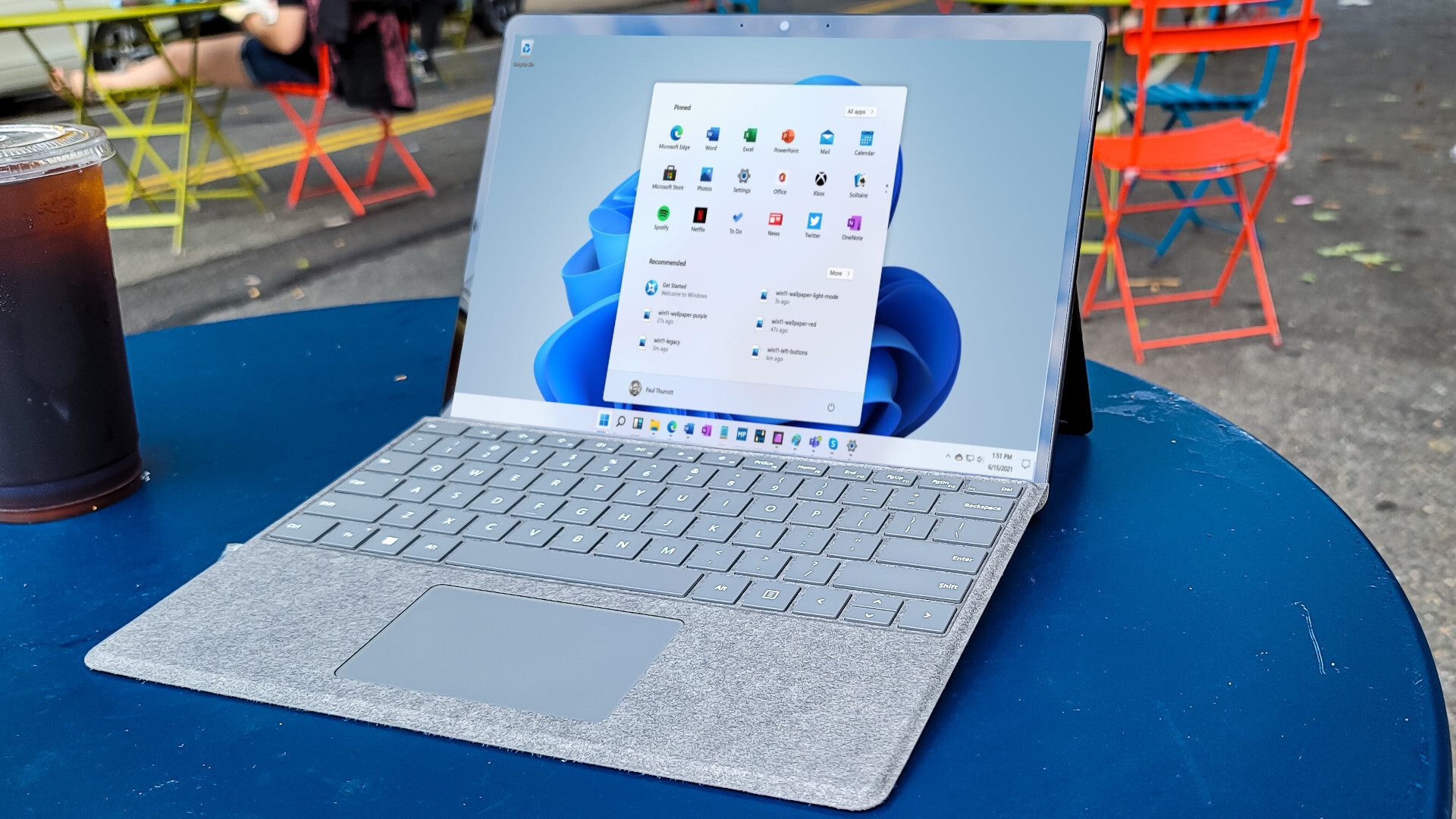 Surface Pro 8 outside on a table showing Windows 11 desktop