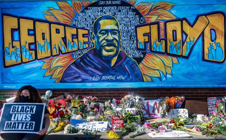 Flowers, signs and balloons are left near a makeshift memorial to George Floyd near the spot where he died while in custody of the Minneapolis police, on May 29, 2020 in Minneapolis, Minnesota.