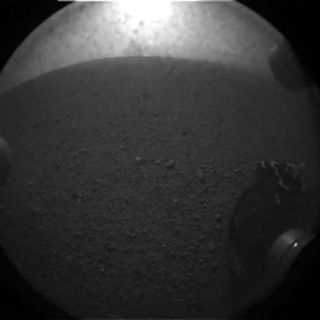 This photo shows the one of the six wheels of NASA's huge rover Curiosity on Mars just after the rover's Aug. 5 PDT, 2012 landing in Gale Crater