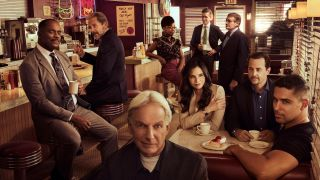 The cast of NCIS season 19 in a diner