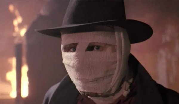 Liam Neeson as Darkman wrapped in bandages