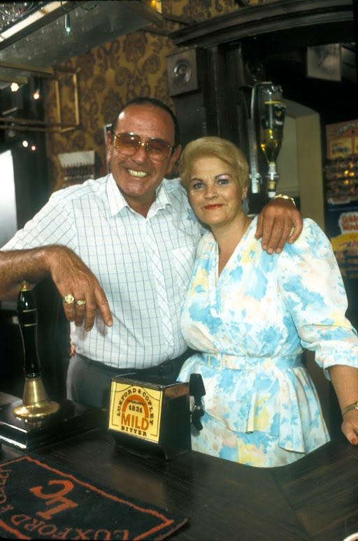 Frank and Pat behind the bar in The Vic in EastEnders