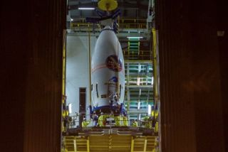 Encapsulated in its protective payload fairing, Italy's PRISMA satellite is positioned atop its Vega rocket.