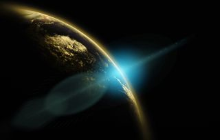 Planet Earth with sunrise and flare glint in background.