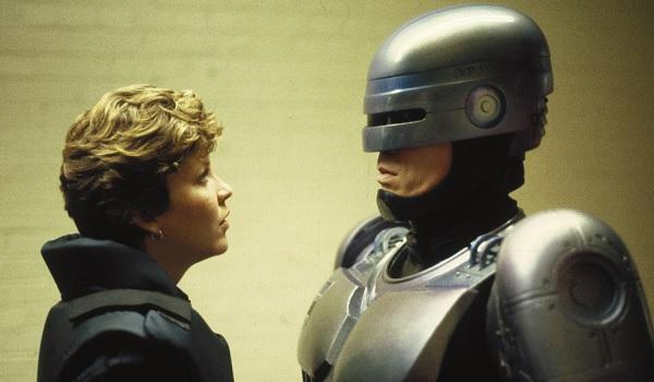 Robocop Anne talks with Robocop in the hall