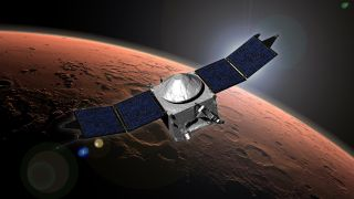 This image shows an artist concept of NASA's Mars Atmosphere and Volatile EvolutioN (MAVEN) spacecraft in orbit around the Red Planet. The Mars atmosphere probe will arrive at the planet on Sept. 21, 2014.