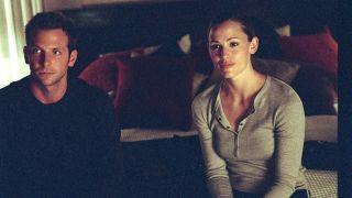 "Jennifer Garner and some guy named Bradley Cooper in ""Alias."""