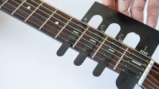 A picture of a guitar fret gizmo