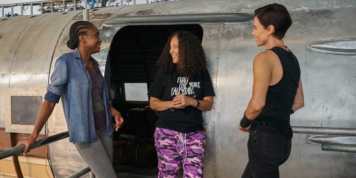 KiKi Layne Gina Prince-Bythewood and Charlize Theron on the set of The Old Guard