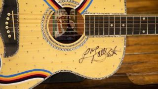 """Dolly Parton is auctioning a """"9 to 5"""" Oscar Schmidt guitar"""