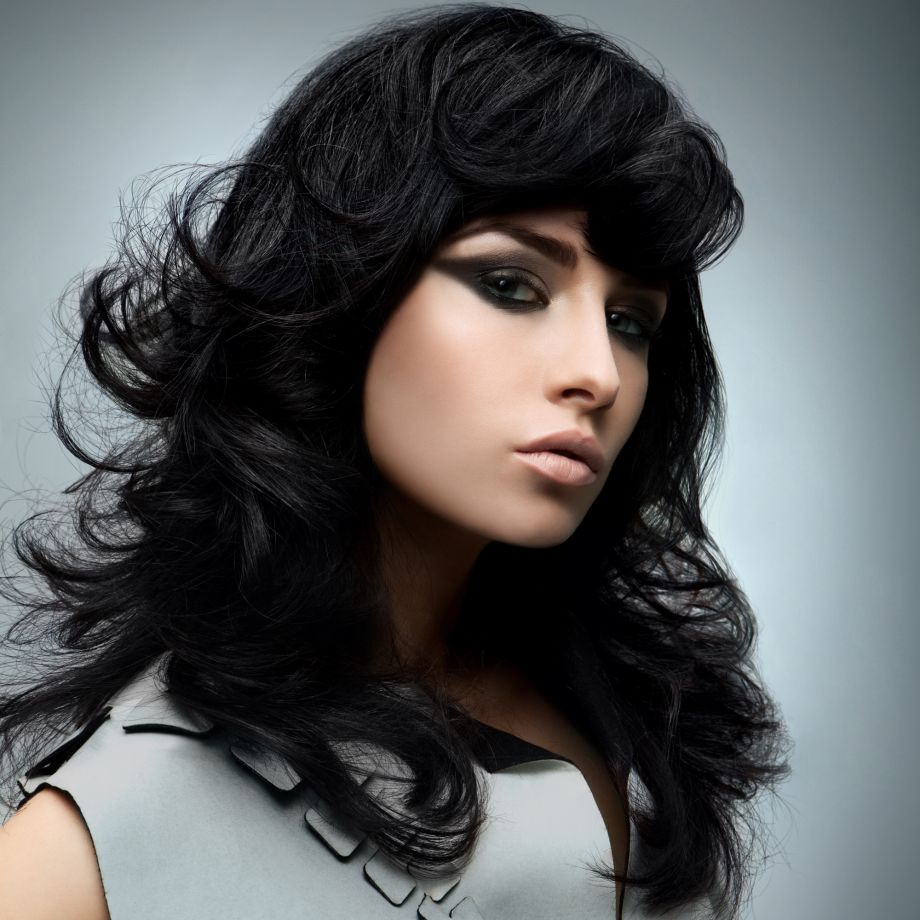 Mid length layered hairstyle with fringe