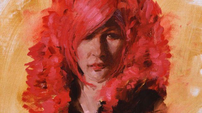 potret seorang wanita dengan rambut merah